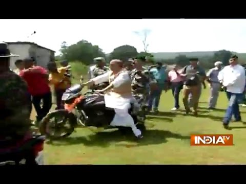 Cabinet Home Minister Rajnath Singh riding on bike at Ranchi CRPF Camp