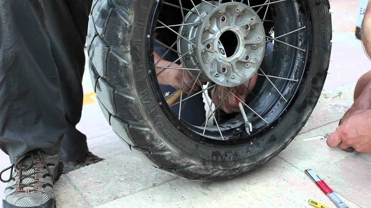 Replacing broken spoke on BMW R1200GS Adventure traveling ...