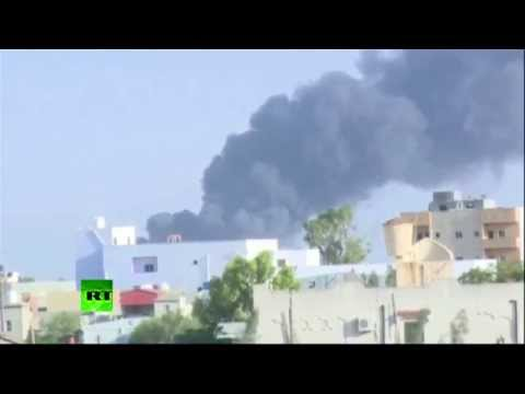 RAW: Oil depot blazes as Libyan militias batter International airport