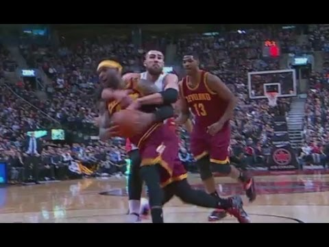 LeBron James tackled by Jonas Valanciunas: Cavaliers at Raptors
