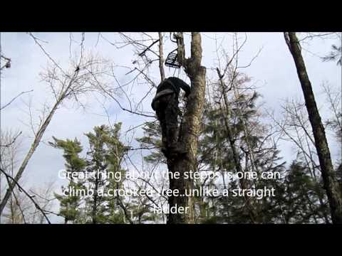 Jim Stepp climbs up a tall install of his famous Stepp Ladder in Casco Maine