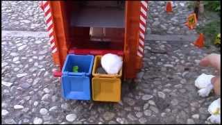 Bruder Garbage Truck Rear Loader picking up trash - video for kids with fun world percussion music