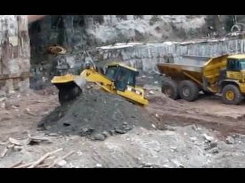Caterpillar 963C track loader working 95 feet below street level