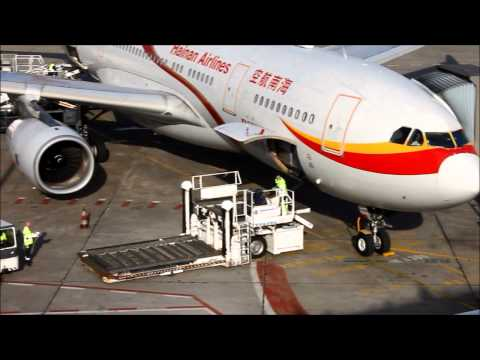 Hainan Airlines Airbus a 330-243 landing in Berlin-Tegel, taxi, unloading the Airbus