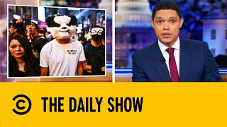 Hong Kong Protesters Defy Mask Ban In Halloween March | The Daily Show With Trevor Noah