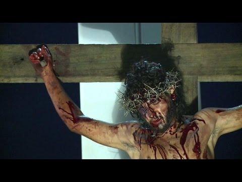 Catholics reenact Christ crucifixion in Caracas slum