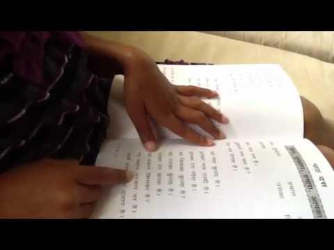 Nisha reading hindi book