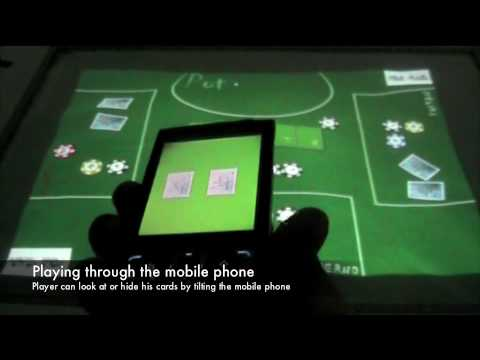 Poker Surface: Combining Mobile Phones and a Multi-Touch Surface in Interactive Card Games