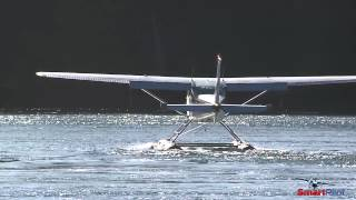 Float Plane   Landing & Taxiing into Moving Water