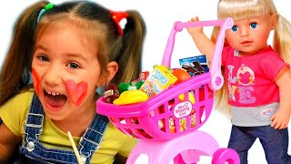 ♫ Shopping with Funny baby Playing with dolls and toys playing hide and seek in Supermarket