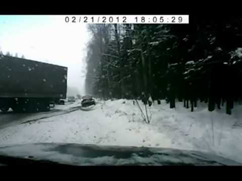 Car avoids Out of control Truck on Ice