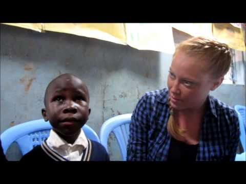 Bridgette meets her sponsored boy in slum