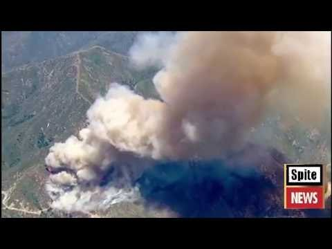 Reservoir fire burns in Angeles National Forest