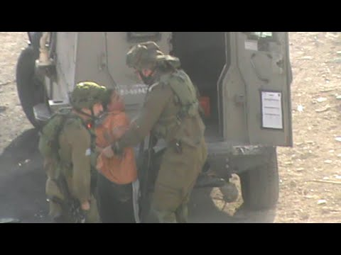 Israeli Soldiers detain developmentally-disabled Palestinian child in Hebron, 19 Oct. 2014