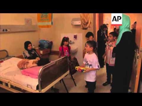 Injured Gaza children receive Eid gifts