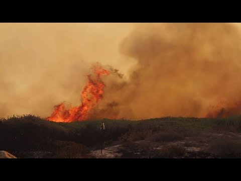 Raw: Calif. Fire Forces Evacuations Along Coast