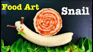 Fruit Food art Snail. Appetizers & snacks for kids. Healthy snack ideas for kids with banana & bread