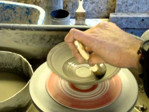 simple slip decorating a few clay pottery bowls on the