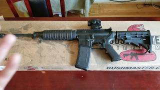 Unboxing the Bushmaster QRC AR15 W/Red Dot