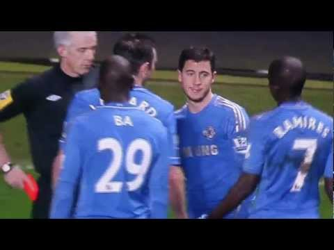 Edin Hazard gets red card for trying to get the ball off the slow ball boy and then kicks him. Red or not?