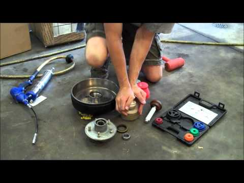 How to pack wheel bearings and add brakes on a trailer