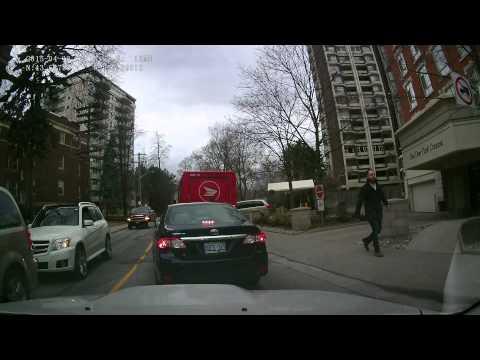 Canada Post @ Work... Blocking Roads during Rush Hour