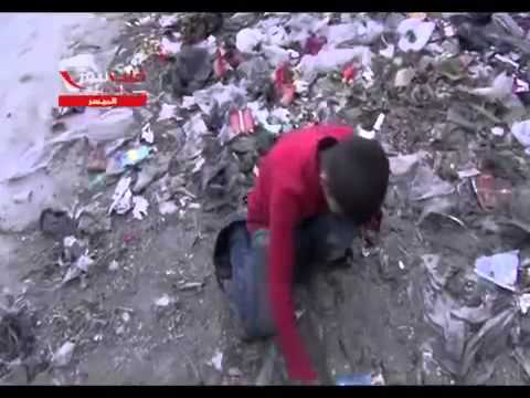 +18 Syria , Aleppo - a Child is Looking for Food in the Garbage