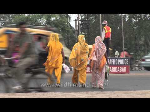Indian women in billowing yellow dresses: Faridabad, Haryana