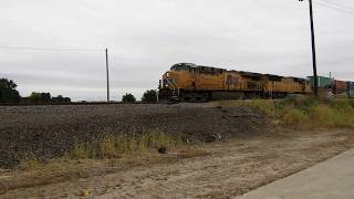 UP 7471 and UP 4097 lead a stack train east through Rochelle IL