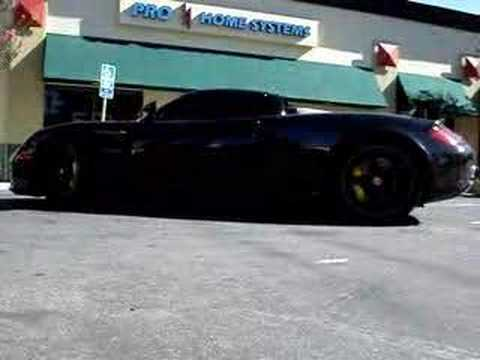Brian records VRAlexander's black Carrera GT raise the electronic spoiler
