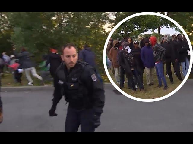 Migrants break through police line in Calais