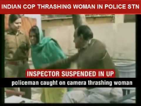 Indian cop thrashing woman in police station