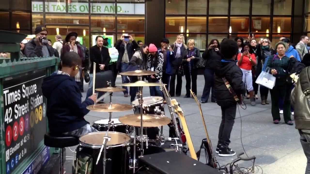 Kids rocking it out times square need to watch youtube
