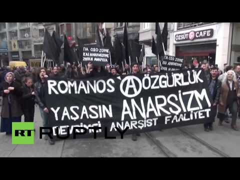 Turkey: Watch anarchists WHACK police with flags