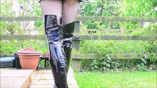 Black PVC mac and thigh boots