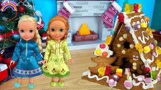 Christmas Gingerbread House Decorating! Elsa and Anna toddler dolls! Candy -Icing -Fun kids video