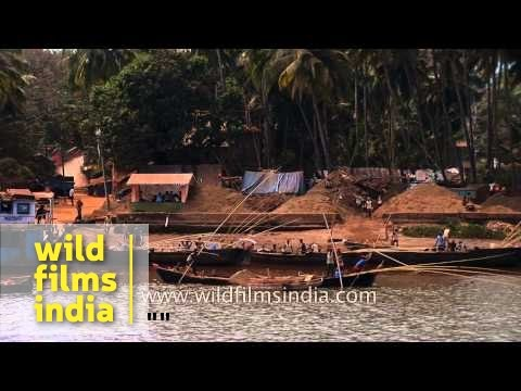 Sand mining on the banks of Mandovi River in Goa