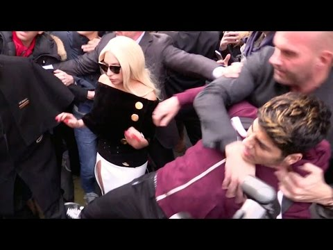 CRAZY FANS ! Lady Gaga hard hotel exit as bodyguard fights a fan in Paris