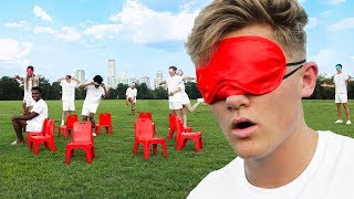 BLINDFOLDED MUSICAL CHAIRS