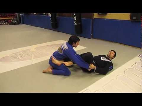 Richmond BJJ Academy - March 2013 Technique of the Month - Open Guard Sweep Combination Image 1