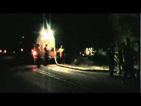 Crash site--mud truck and car--
