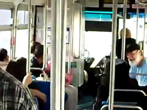 Bearded man beats up fake thug on bus