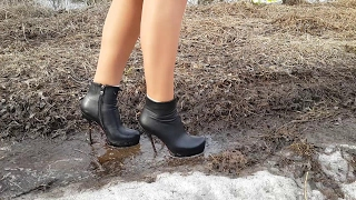 High heels boots with broken heel wet and muddy
