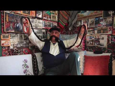 مصر العربية | تركي صاحب أطول شارب في العالم بمترين و60 سنتيمتر