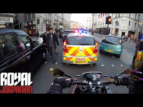 Police and Ambulance through the traffic in London