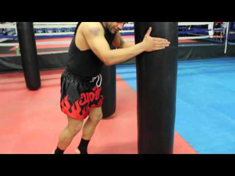 JMTK Head Trainer Andy Zerger Demonstrates a Muay Thai Knee Drill on Heavy Bag Image 1