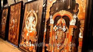 Hand made paintings of God at 27th Surajkund International Crafts Mela 2013