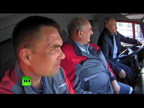 RAW: Putin drives truck across newly-opened Crimean bridge
