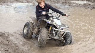 KIDS ATV QUAD DRIFTING AND DONUTS IN MUD.
