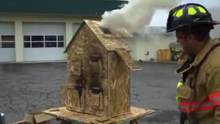 Salem firefighter demonstrates fire flow paths by burning down doll house